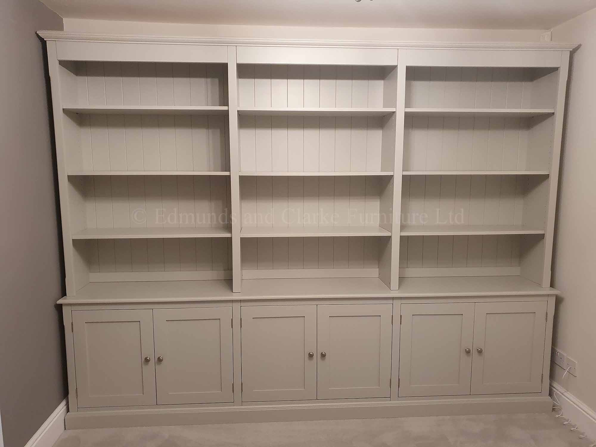 Painted 6 door wide bookcase with cupboards below painted pavilion grey all over