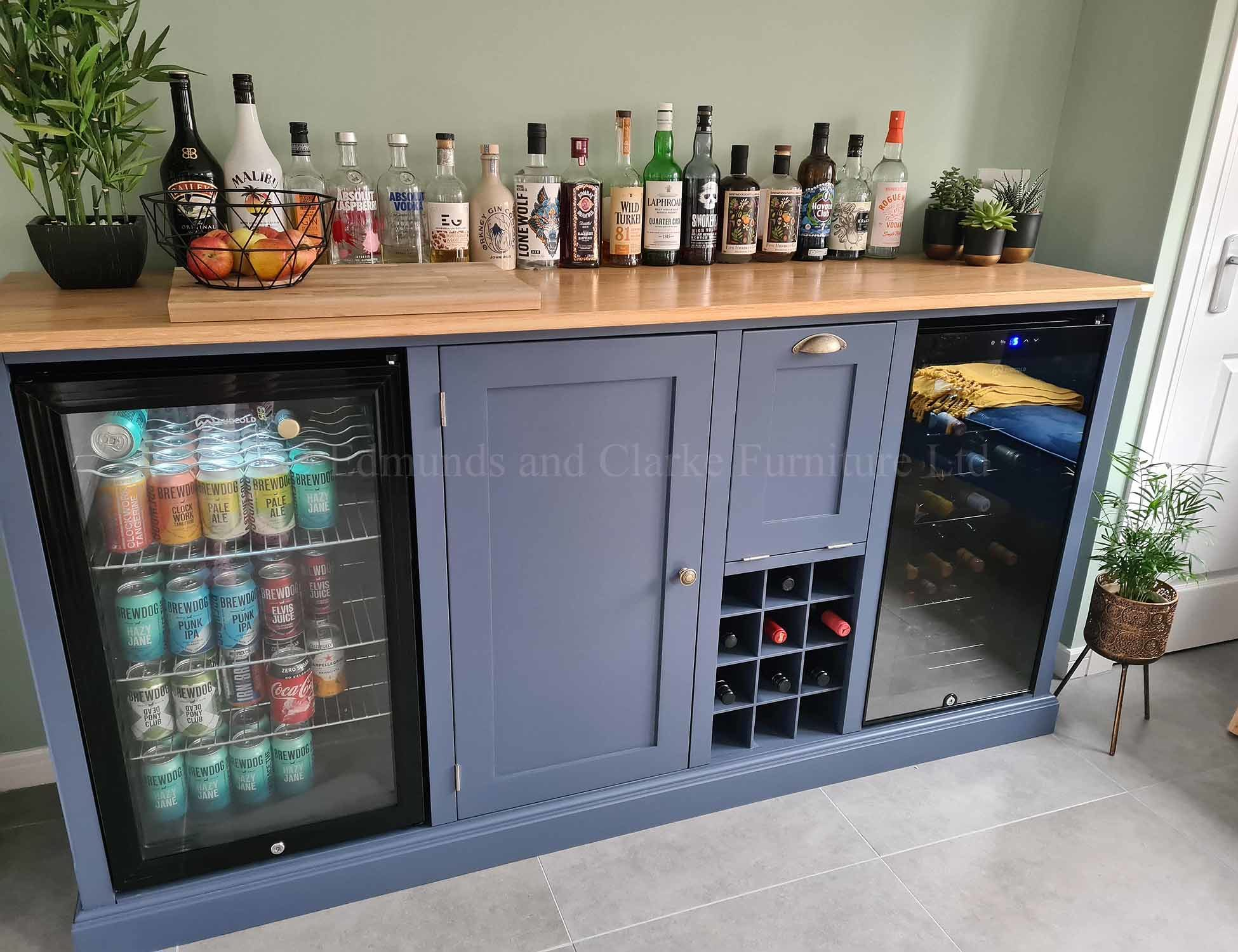 Sideboard housing beer and wine cooler with wine rack and useful cupboard storage painted with solid oak top