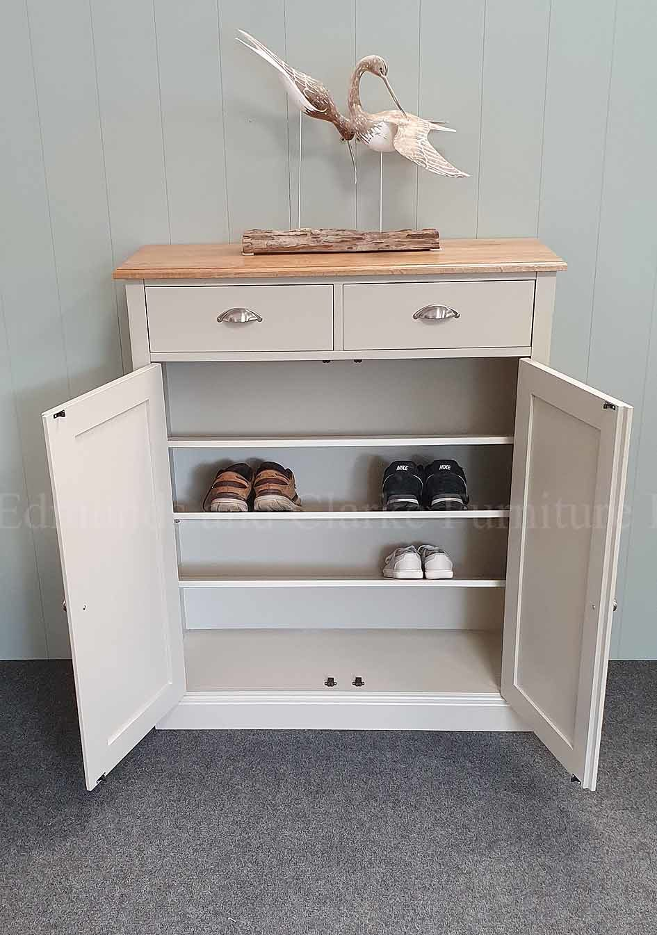 painted grey shoe cupboard with two doors and two drawers above, angled internal adjustable shelves